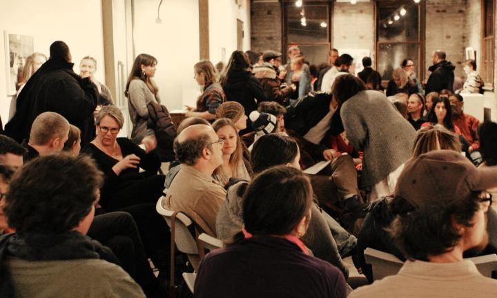 People talking at Arts + Literature Laboratory