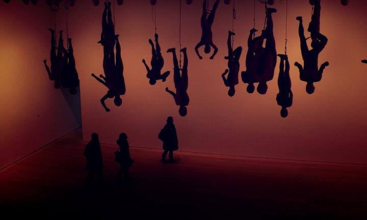 circus people hanging upside down