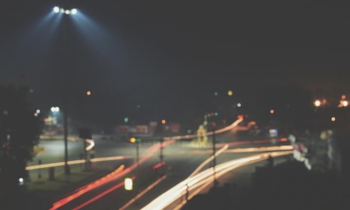 street scene at night car lights