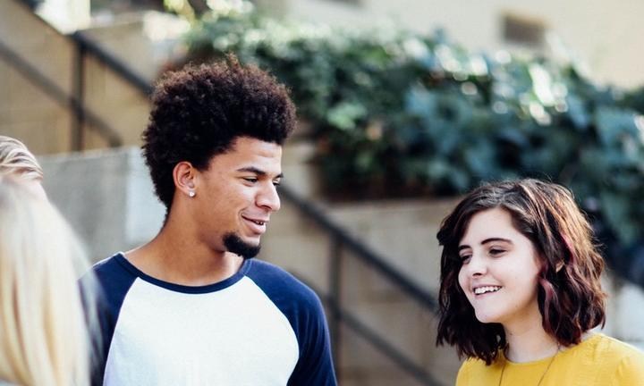 Teens talking and smiling